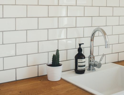 Caring for unpaper towels isn't hard. Pictured is a beautiful white kitchen.