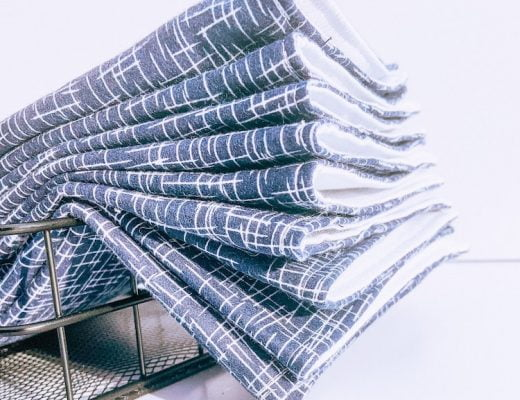 A set of blue cloth paper towels in a basket